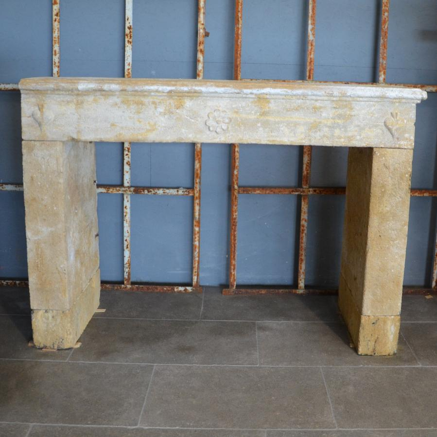 antique french limestone fireplace