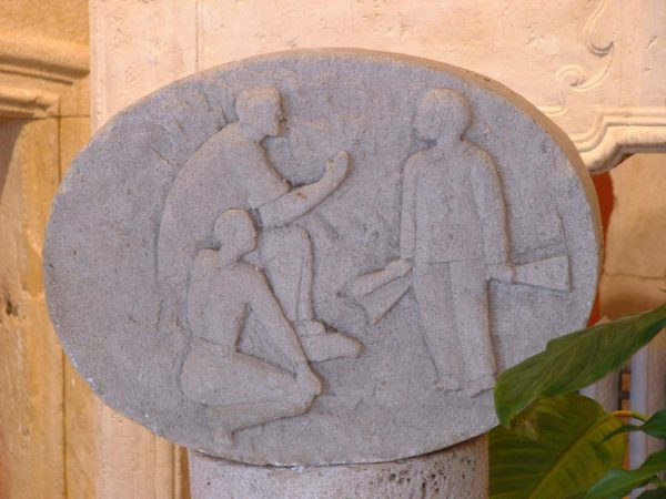 carved limestone plaque