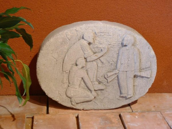 carved limestone plaque with low relief