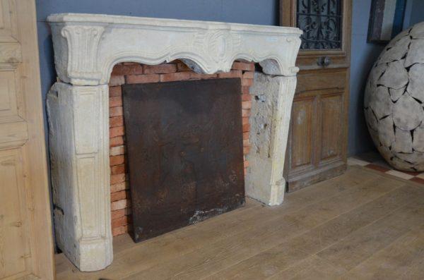 Antique limestone fireplace