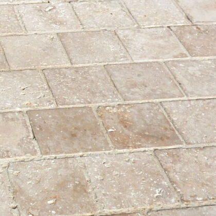 new antiqued cobblestone travertin