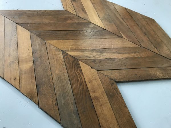 stock of reclaimed chevron oak parquet