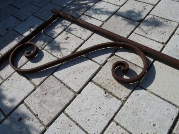 Antique wrought iron support arm