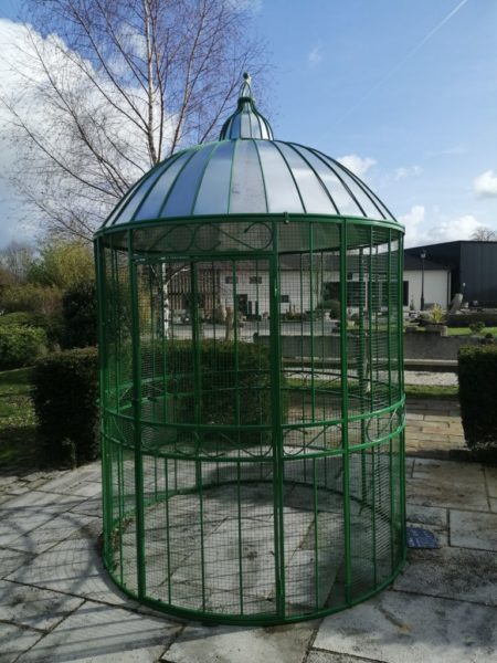 gazebo birdcage in green color in dormed grey roof