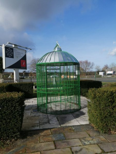 green birdcage gazebo