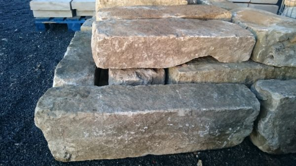 antique reclaimed pavement kerb in hard sandstone