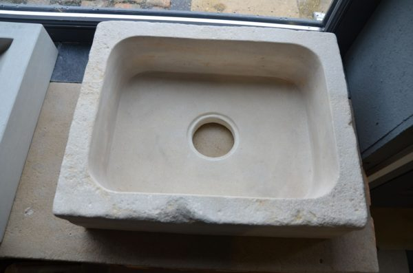 antique sink in natural stone