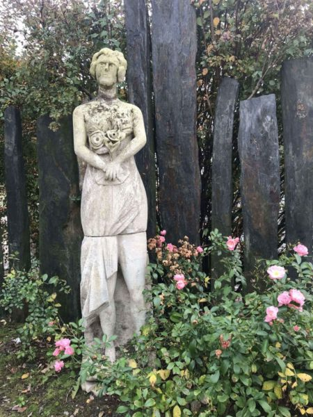 antique statue of a women with flowers