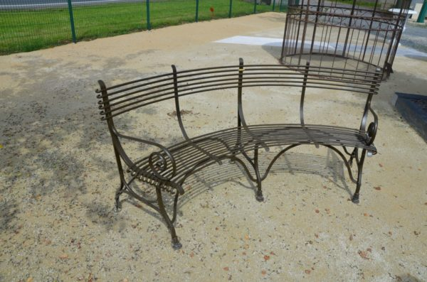 brown curved bench for garden