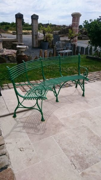 green curved bench in exterior