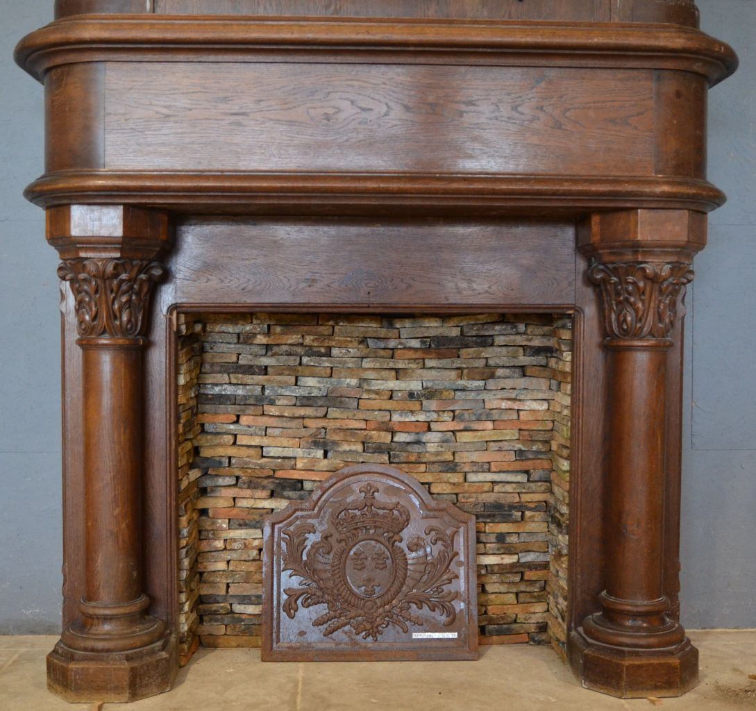 antique gothic style fireplace in oak