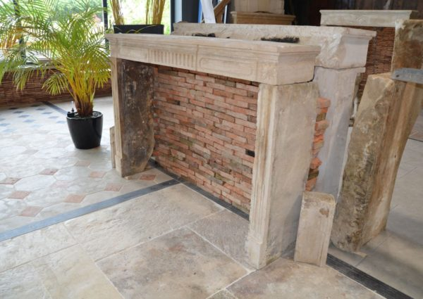 Antique French limestone Louis XVI chimneypiece