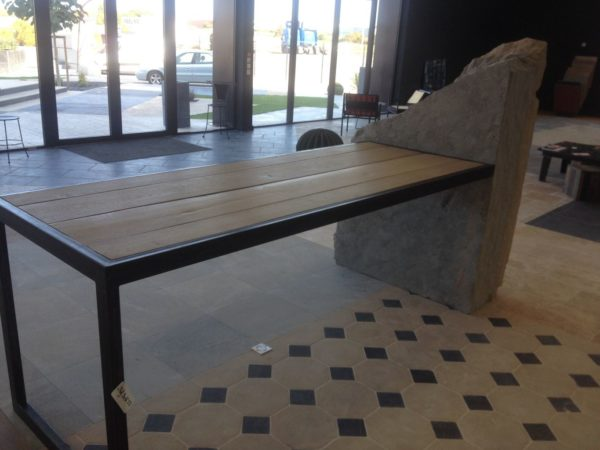 table with rock inside and iron