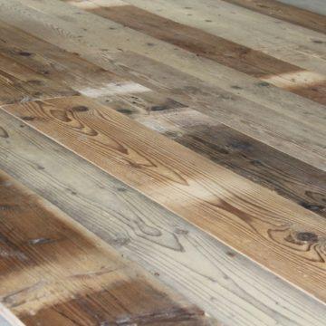 Wide reclaimed pine floorboards