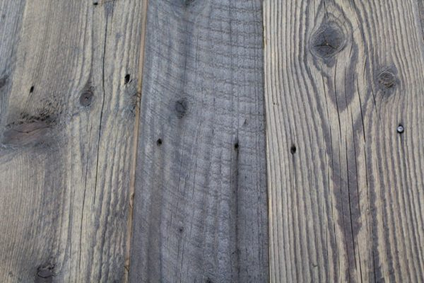 Reclaimed slow-growth pine wall cladding, which has been straight-edged and surface brushed.