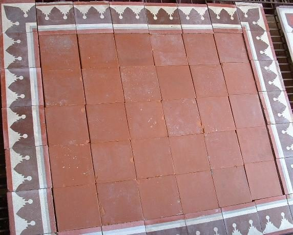 Terracotta tiles with decorative cement tile border