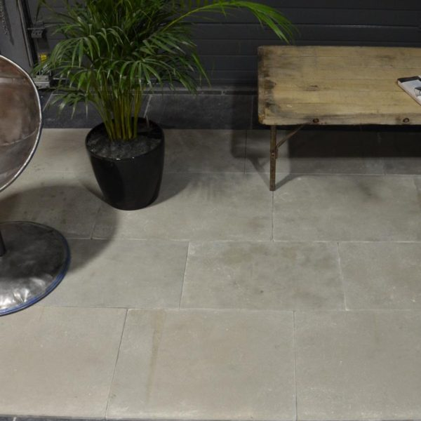 New antiqued limestone Grey