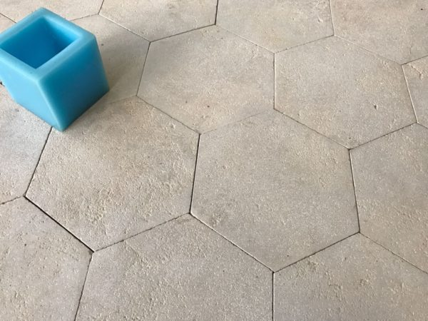 Antiqued limestone hexagon tiling