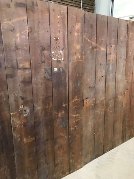 lots of antique doors that create a wall