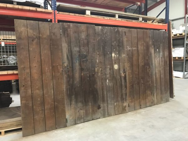 wooden wall with many antique doors