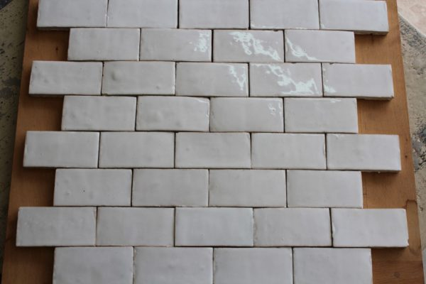 Hand-made white glazed terra cotta tiles