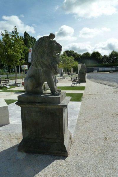 statue de lion en pierre reconstituée
