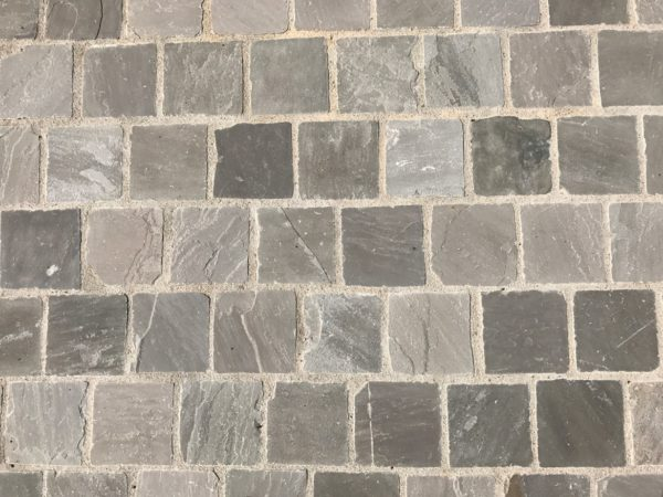 grey khandla pavers outside in front of house