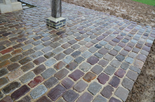 antique french granite and gres paving during a rainy day