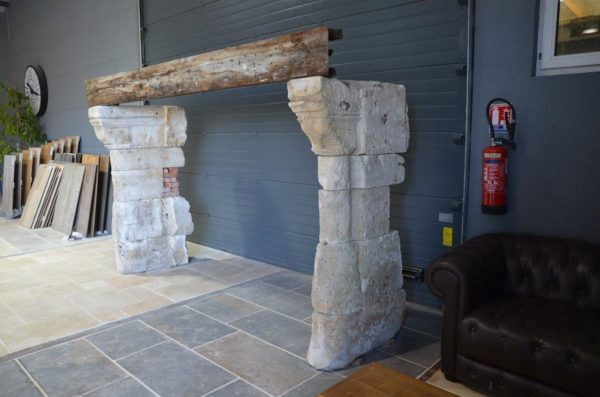 antique oak fireplace with limestone