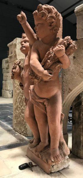 cherubs statue in terra cotta style antique