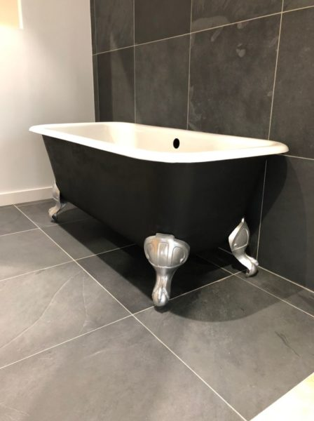 antique bathtub in black, silver and white