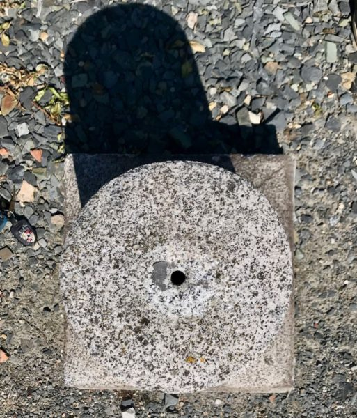 antique small post in granite stone