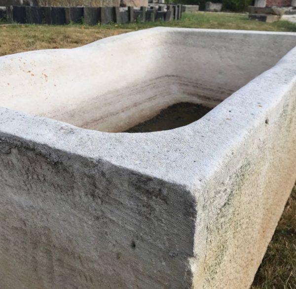 corner of our antique light-tone limestone trough