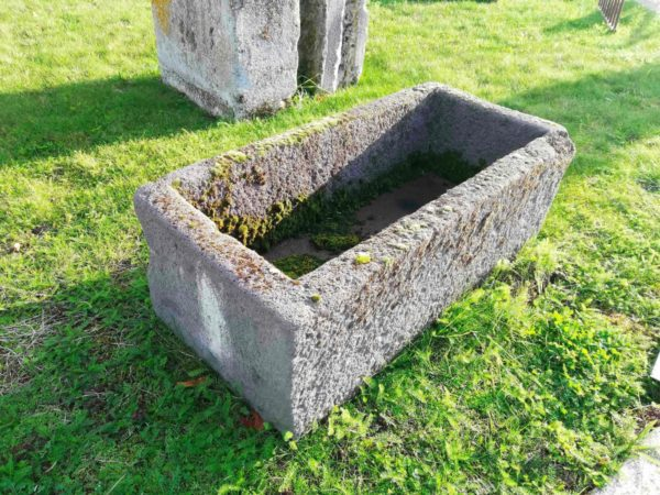 ancient or old grey stone trough