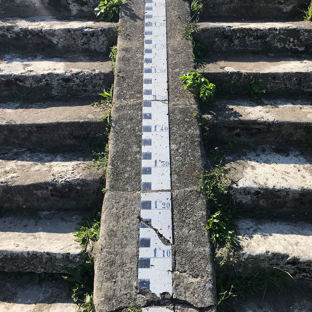 water markers in limestone of the steps