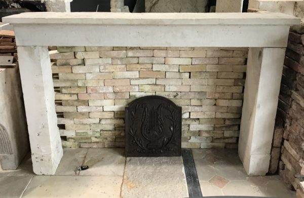 front of the french farmhouse fireplace