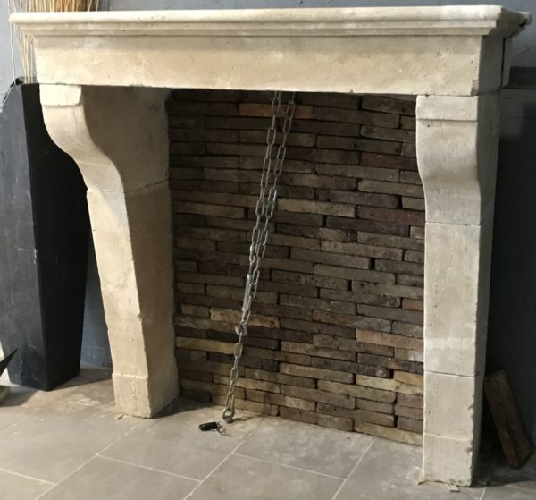Limestone fireplace from France