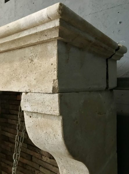 zoom of the french stone fireplace corbel