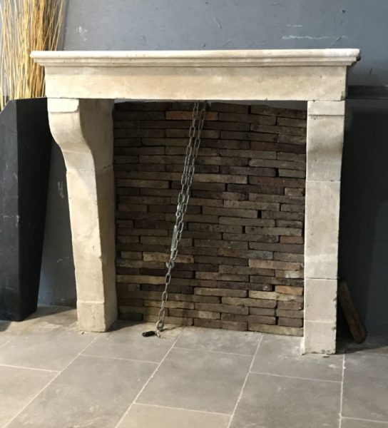 limestone farmhouse fireplace in our showroom