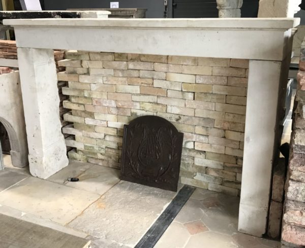 front of the limestone kitchen fireplace