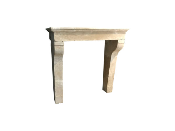 antique farmhouse fireplace in beige limestone from France