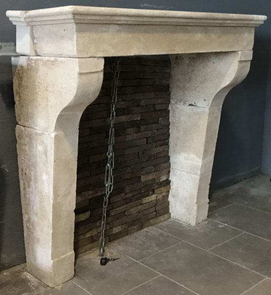 simple antique stone chimneypiece in limestone