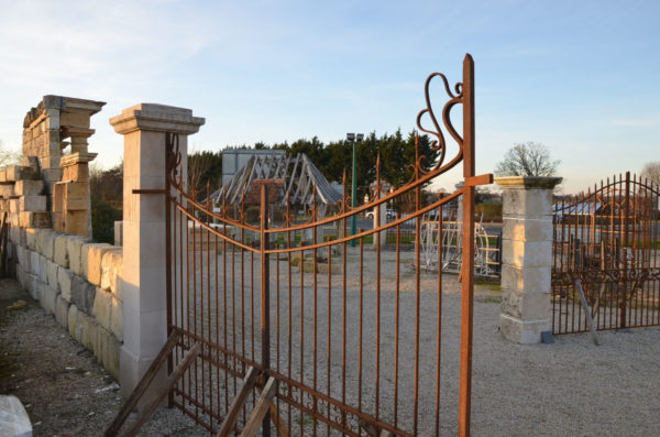 iron entrance gates near pillars
