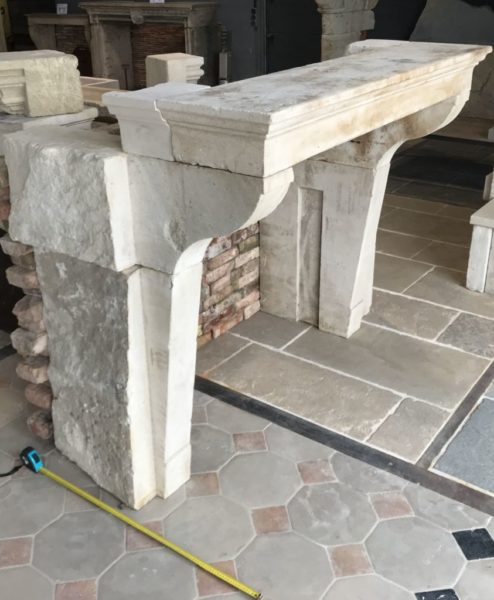 antique limestone chimneypiece from France