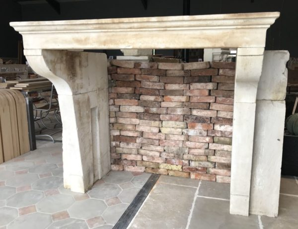 antique french chimneypiece with reclaimed stone
