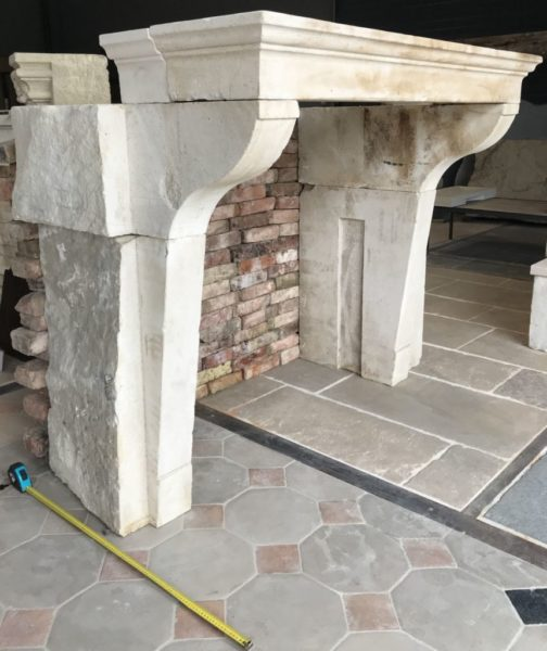 classic french limestone fireplace from France