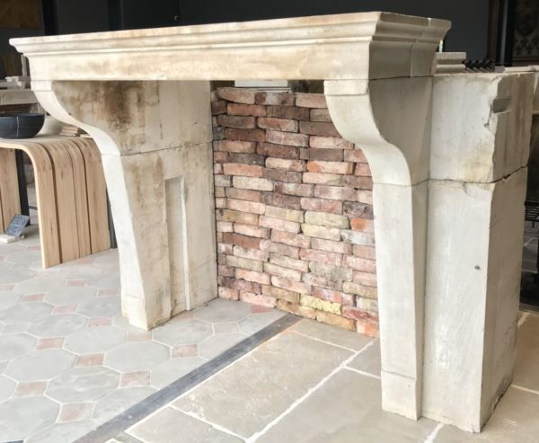 french antique mantel in limestone