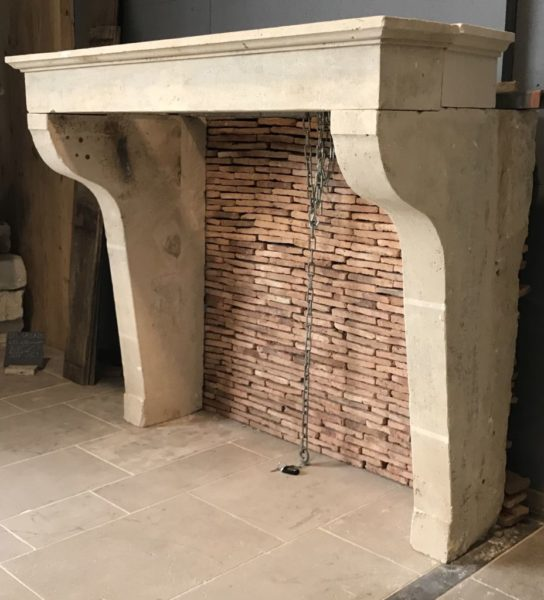 antique french mantel with antique bricks