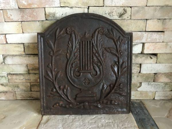 antique cast iron fireback dark