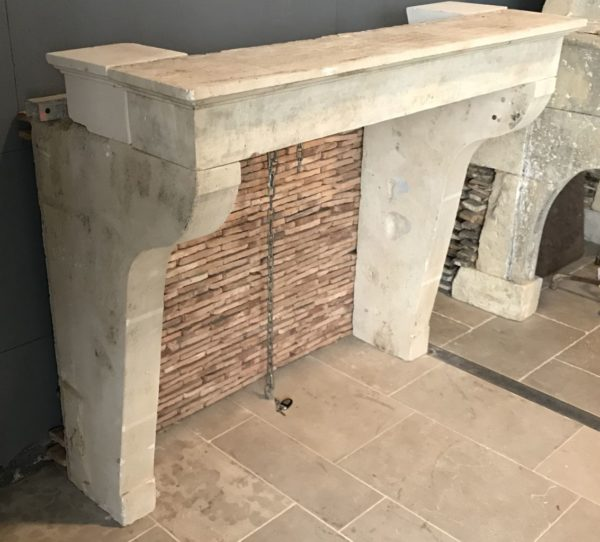 antique limestone chimneypiece in our showroom